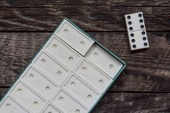 Old vintage dominoes, lonely win Stock Photo