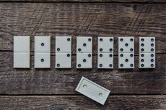 Old vintage dominoes, lonely win Stock Photos
