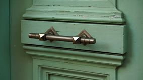 Old vintage door handle. Green door stock photos