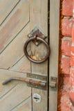 Old vintage door handle on a wooden door stock photography