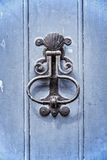 Old vintage door knocker on a blue wooden door Stock Photo