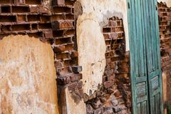 Old Vintage Door On The Old Brick Wall.Perspective view. Stock Photo