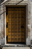 Old vintage door in the stone house. Paris architecture.  Royalty Free Stock Image