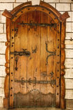 Old vintage door. Old wooden vintage Ukrainian door  with call in the form of a cord Royalty Free Stock Photos