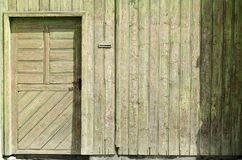 Old vintage door on a wooden wall. In a romanian village close to fagaras mountains Stock Image