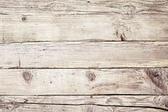 Old vintage faded natural wood background texture. With cracks and knots in a full frame view royalty free stock photo