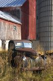 Old Vintage Farm Truck by Barn Royalty Free Stock Photos