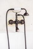 Old vintage faucet on bathtub. Decoration in bathroom interior - Light Vintage Filter Royalty Free Stock Images