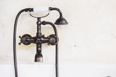 Old vintage faucet on bathtub Stock Images