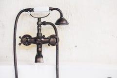 Old vintage faucet on bathtub. Decoration in bathroom interior - Light Vintage Filter Stock Images
