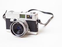 Old Vintage Film Camera. An old 35mm rangefinder film camera over white background Stock Images