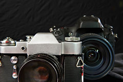 Old vintage film camera and digital one. Old vintage film camera on background of digital camera royalty free stock photography