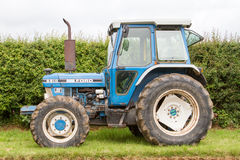 A old vintage ford 6810 tractor. A old blue ford vintage tractor parked up on grass verge Royalty Free Stock Image