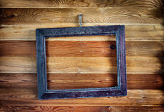 Old vintage frame hanging on the wall Royalty Free Stock Photo