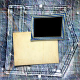 Old vintage frame on jeans background Stock Photos