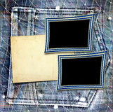 Old vintage frame on  jeans background Royalty Free Stock Photo