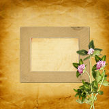 Old vintage frame for photos and bouquet of flowers Royalty Free Stock Photography