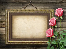 Old vintage frame for photos and a bouquet of yellow roses Royalty Free Stock Photography