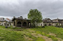 The old vintage ghost town, with ragged houses Stock Images