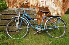 Old vintage girl's bicycle with a basket Stock Photo