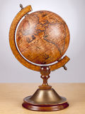 An old vintage globe on a small stand Stock Images