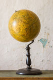 Old Vintage globe. On old table Royalty Free Stock Image