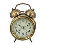Old vintage gold alarm clock Stock Photo