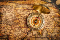 Old vintage golden compass on ancient map Royalty Free Stock Photos