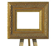 Old vintage golden picture frameon a stand isolated over white Stock Photography