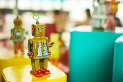 Old vintage golden robot toy on a pedestal. Robotics and design of the past. Royalty Free Stock Image