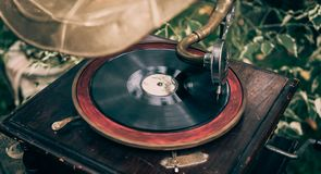 Old vintage gramophone or turntable player with disc close up Stock Photography