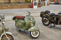 Old Vintage green motorcycle on the streets Royalty Free Stock Image