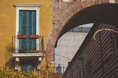Old vintage green window and archway in Verona Royalty Free Stock Photography