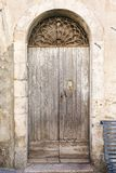 Old vintage green wooden door Stock Photo