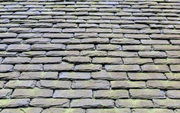 Old vintage grunge natural stone roof tales on Scottish house Royalty Free Stock Photos