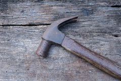 Old vintage hammer hand tools on wood background Stock Images