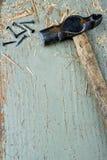 Old vintage hammer on wooden background Stock Images