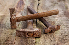 Old vintage hammers on a wooden background Stock Image