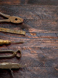 Old vintage hand tools on wooden background Stock Image