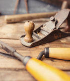 Old vintage hand tools on wooden background. Stock Photo