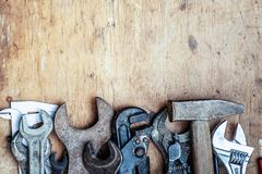 Old vintage hand tools on wooden background. Top view. With copy space.  stock image