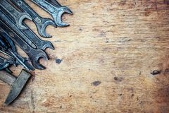Old vintage hand tools on wooden background. Top view. With copy space.  royalty free stock photo