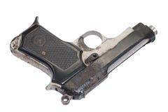 Old vintage handgun on white Stock Images