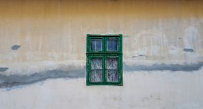Old house light yellow wall with green wooden window. Old vintage house light yellow wall with green wooden window royalty free stock photography