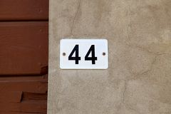 Old vintage house number 44 royalty free stock image