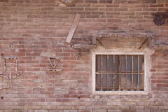 Old vintage house red brick wall and rustic window Royalty Free Stock Photography