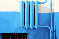 Old vintage iron heater radiator painted in blue Stock Photo