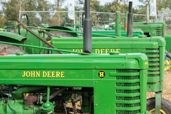 Old vintage john deere tractors in a row Royalty Free Stock Photo