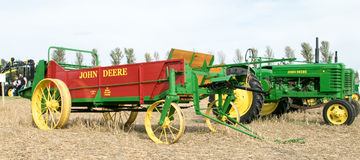 Old vintage john deere trailer and tractors Stock Images