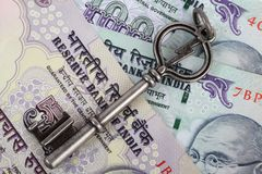 Old vintage key on rupees Stock Images